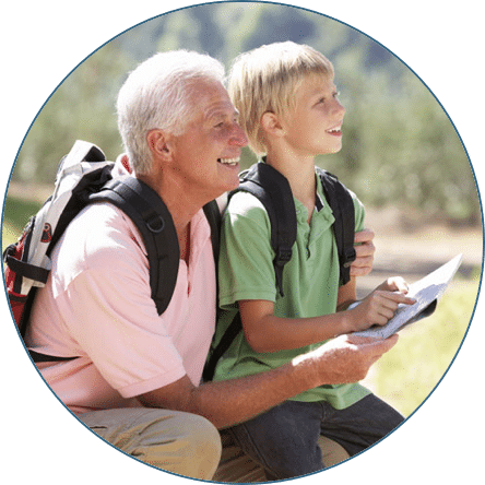 Older man with young boy hiking