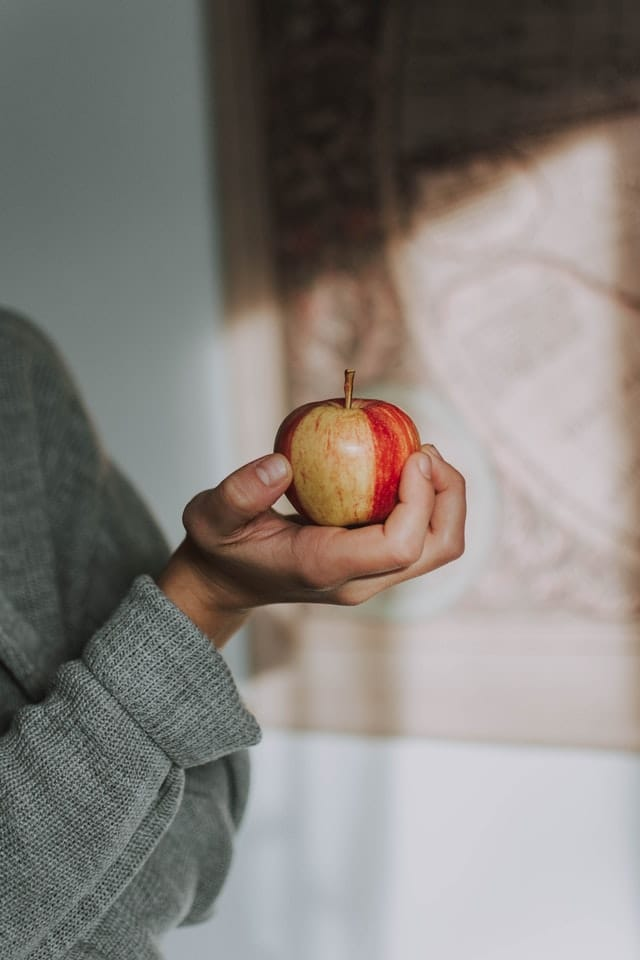 person holding an apple