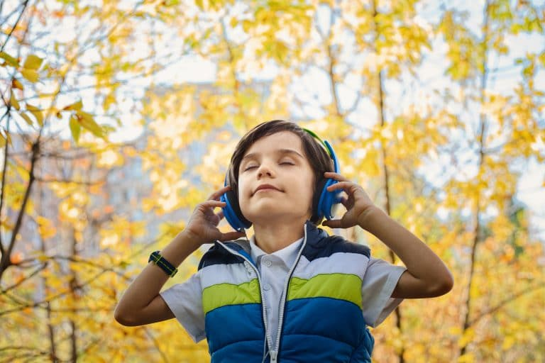 photo of a young boy wearing headphones